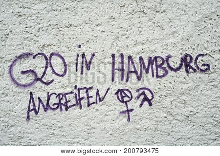 MAGDEBURG, GERMANY - AUGUST 22, 2017: Incitement to violence on a house wall in Magdeburg. Lettering with the words: