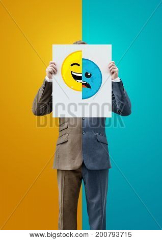 Businessman Holding Happy and Sad Emoticon Faces. Concept