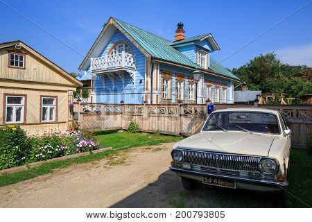 SUZDAL/ RUSSIA - AUGUST 19, 2017. Wooden house with Soviet Volga car in front of him. Lebedeva street, Suzdal, Russia.