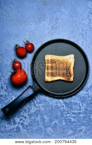 Toast On Frying Pan With Red Tomato Vegetable