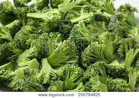 Many sliced green broccoli sprouts as background