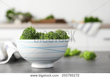 Fresh green broccoli sprouts in bowl on kitchen table