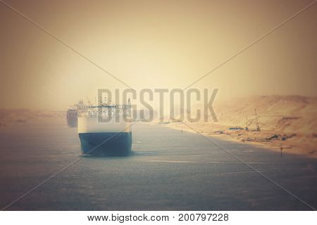 The Suez Canal - a ship convoy passes through the new eastern extension canal Lomo Effect