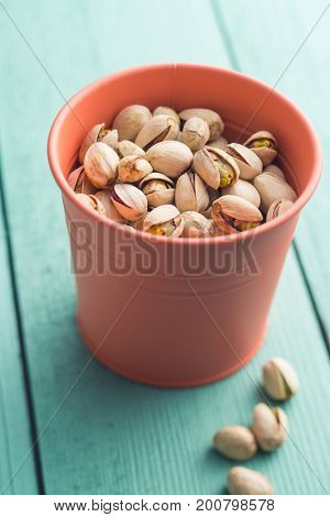 Dried pistachio nuts in cup.  Pistachio kernel.