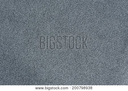 A close-up shot of grey fabric texture