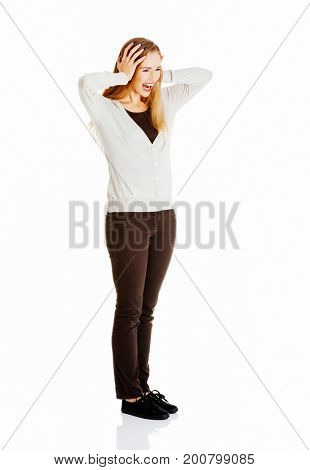 Beautiful positive and casual woman expressing surprise.