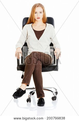 Beautiful casual woman sitting on a chair.