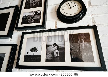 Family framed Photos of couples in an interior room on the wall clock.