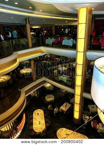 Barcelona, Spain - September 06, 2015: The main restaurant at Royal Caribbean, Allure of the Seas at Barselona on September 6, 2015. Passengers are having supper inside the ship