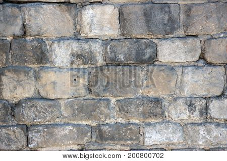 Old brickwork made of white brick. Background texture