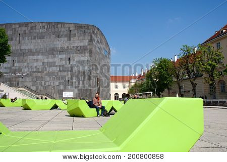 VIENNA, AUSTRIA - APR 29th, 2017: Mumok Museum Modern Kunst - Museum of Modern Art in the Museumquartier with young people chilling on benches in front. Established in 2001.