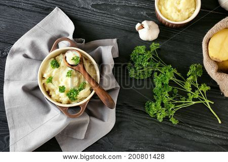Composition with mashed potatoes in casserole on wooden background