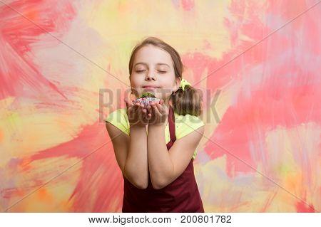 Baby Girl With Closed Eyes Enjoy Eating Cupcake