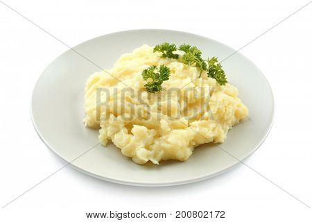 Plate with mashed potatoes on white background