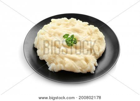 Black plate with mashed potatoes on white background
