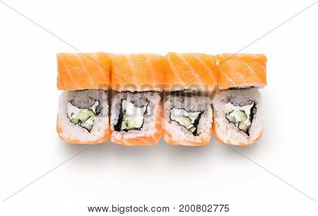 Traditional japanese food delivery. Philadelphia salmon set isolated at white background, closeup. Healthy asian restaurant meals, top view