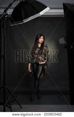 Woman in studio with light gear