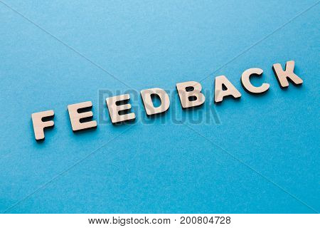 Word Feedback on blue background. Modern technologies, successful business, communication concept