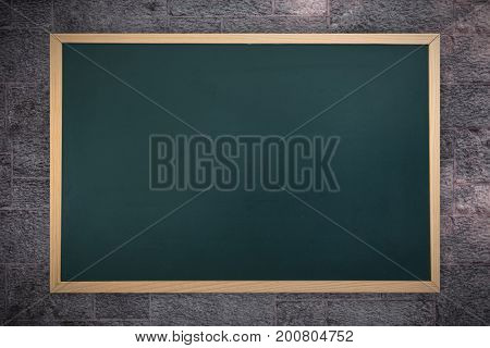 Image of a chalkboard    against image of a wall