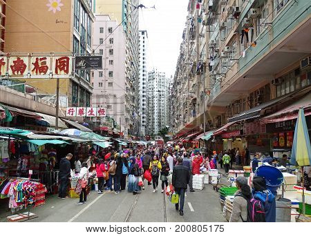 North Point, Hong Kong - February 10, 2016: Many people stroll along the many shops on Chun Yeung Street in the North Point district of Hong Kong.