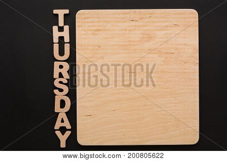 Word Thursday with blank wooden board. Timetable, day of week, to-do-list, time management concept