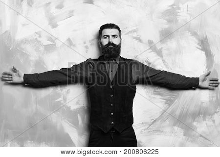 Bearded Brutal Caucasian Hipster Standing With Raised Hands