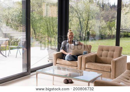 Real Woman Using laptop At Home Drinking Coffee Enjoying Relaxing