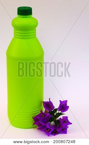Bottle of lye. Disinfectant bottle with a leaf.
