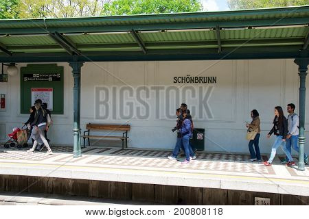 VIENNA, AUSTRIA - APR 30th, 2017: Passengers walking and waiting for a train at the subway or tram station Schonbrunn Palace.