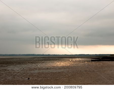 Sunsetting In The Distance Stunning Light Over Mudflats Casting Glow Pretty Beach