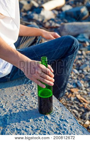 Person with the Bottle of a Beer outdoor