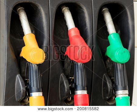 Gas pump nozzles at a gasoline station