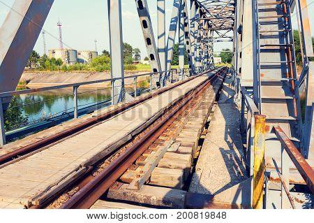 Railway Bridge Over The Pripyat River, Chernobyl. Metal Structure, Bridge Supports. Bridge, Years La