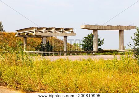Abandoned Unfinished Bridge Over The Motorway. Overpass. The Construction Of The Bridge. The Destroy
