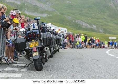 Col du Lautaret France - July 19 2014: Row of empty police bikes in front of the spectators on the side of the road on Col du Lautaret in Alps during the stage 14 of Le Tour de France 2014.