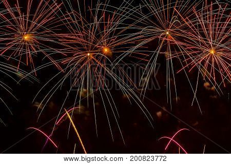 Bright multicolored firework from glowing spheres and flickering stars. Beautiful modern background for all bright occasions.
