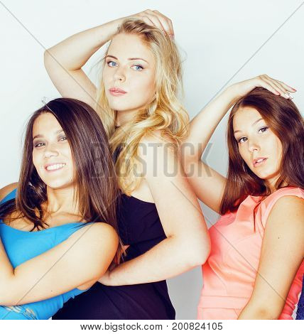 group of many cool modern girls friends in bright clothers together having fun isolated on white background, happy smiling lifestyle people concept close up