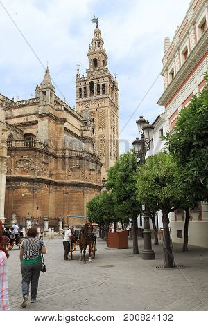 SEVILLE, SPAIN - MAY 21, 2017: The Giralda Tower is the bell tower of the Cathedral of Seville built in the 12th century as a minaret at the mosque.