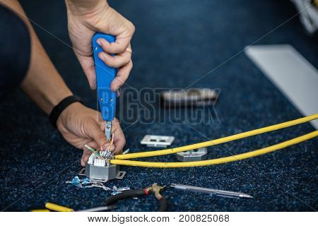 Worker Connect A Network Cable With Rj45 Sockets By Punch-down Tool, Process Of Laying The Local Net