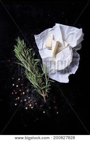 Bunch Of Herbs With Cheese On Rustic Board