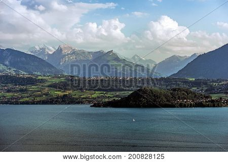 Scenic Lake Thun in Switzerland Jungfrau Region. Lake and Mountains Scenery