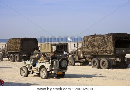Army Trucks And Jeeps At Beach