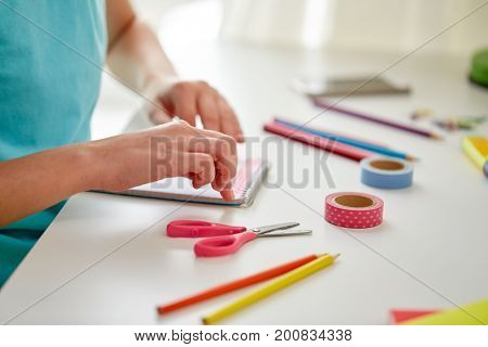 people, children, creativity and art concept - girl hands making something at home