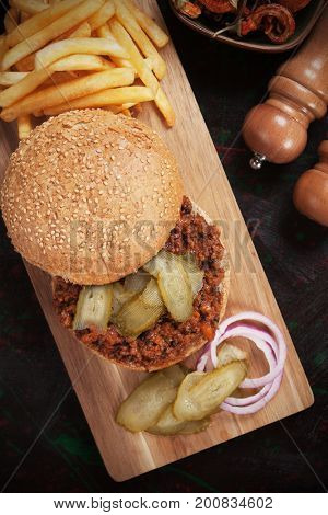 Sloppy joes, ground beef burger sandwich with french fries and pickles