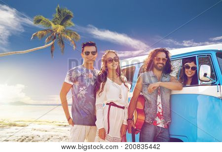 summer holidays, road trip, travel and people concept - smiling young hippie friends with guitar at minivan car over tropical beach background