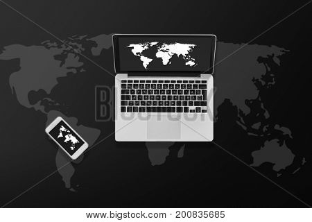 social media and technology concept - laptop computer with world map on screen and smartphone top view
