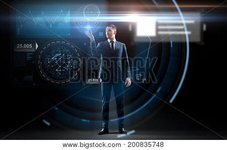 business, people, augmented reality and future technology concept - businessman working with charts on virtual screen over black background