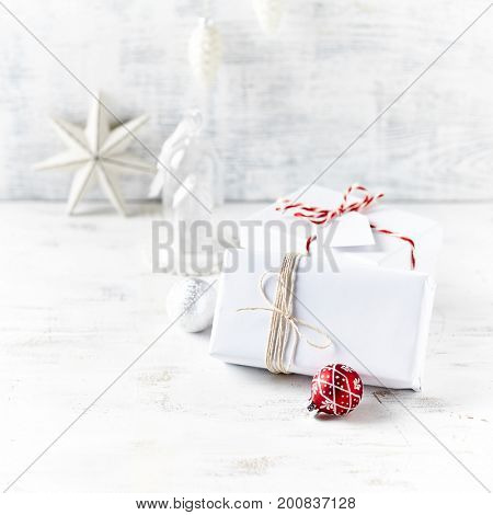 An Arrangement of Christmas Presents wrapped in white gift paper