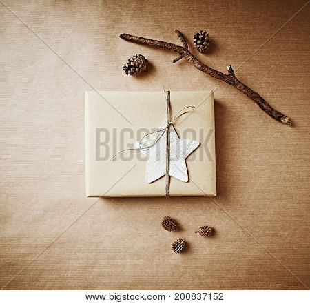 Christmas Present on Brown Paper Background