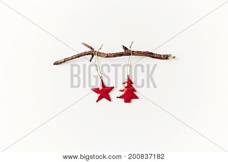 Two Christmas Tree Decorations on a Dry Tree Branch